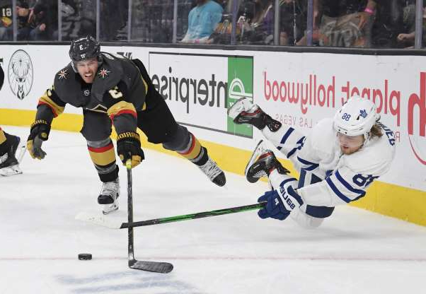 Slide 4 of 50: LAS VEGAS, NEVADA - NOVEMBER 19:  William Nylander #88 of the Toronto Maple Leafs passes against Brayden McNabb #3 of the Vegas Golden Knights in the third period of their game at T-Mobile Arena on November 19, 2019 in Las Vegas, Nevada. The Golden Knights defeated the Leafs 4-2.  (Photo by Ethan Miller/Getty Images)