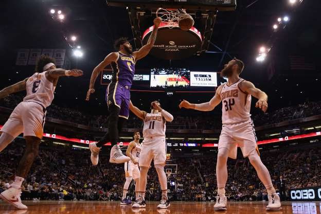 Slide 44 of 50: PHOENIX, ARIZONA - NOVEMBER 12: JaVale McGee #7 of the Los Angeles Lakers slam dunks the ball over Aron Baynes #46 of the Phoenix Suns during the second half of the NBA game at Talking Stick Resort Arena on November 12, 2019 in Phoenix, Arizona. The Lakers defeated the Suns 123-115. NOTE TO USER: User expressly acknowledges and agrees that, by downloading and/or using this photograph, user is consenting to the terms and conditions of the Getty Images License Agreement  (Photo by Christian Petersen/Getty Images)