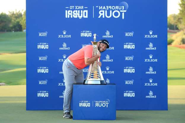 Slide 47 of 50: DUBAI, UNITED ARAB EMIRATES - NOVEMBER 24: Jon Rahm of Spain celebrates with the Race to Dubai trophy following his victory during Day Four of the DP World Tour Championship Dubai at Jumerirah Golf Estates on November 24, 2019 in Dubai, United Arab Emirates. (Photo by Andrew Redington/Getty Images)