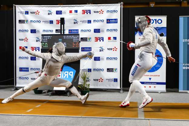 Slide 48 of 50: ORLEANS, FRANCE - NOVEMBER 24:  Sofya Velikaya of Team Russia (left) fences Jisu Yoon of Team Korea during the gold medal match of the team competition at the Women's Sabre World Cup on November 24, 2019 at the Palais des Sports in Orleans, France. (Photo by Devin Manky/Getty Images)
