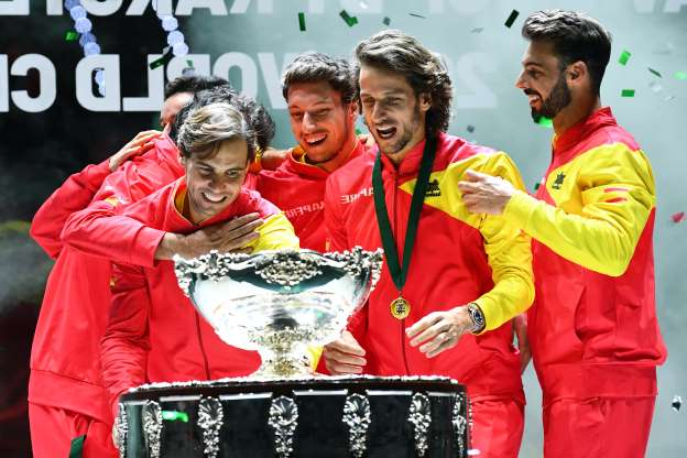 Slide 5 of 50: Spain's Rafael Nadal (R) and teammates pose with the winner's trophy during the trophy ceremony after winning the Davis Cup Madrid Finals 2019 in Madrid on November 24, 2019. (Photo by GABRIEL BOUYS / AFP) (Photo by GABRIEL BOUYS/AFP via Getty Images)