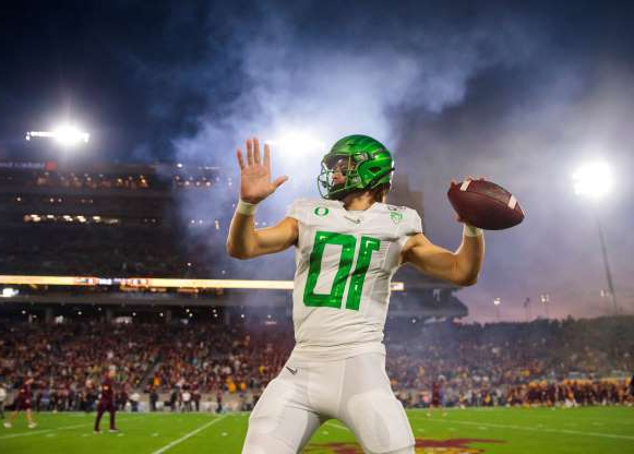 Slide 50 of 50: Nov 23, 2019; Tempe, AZ, USA; Oregon Ducks quarterback Justin Herbert warms up prior to the game against the Arizona State Sun Devils at Sun Devil Stadium. Mandatory Credit: Mark J. Rebilas-USA TODAY Sports     TPX IMAGES OF THE DAY
