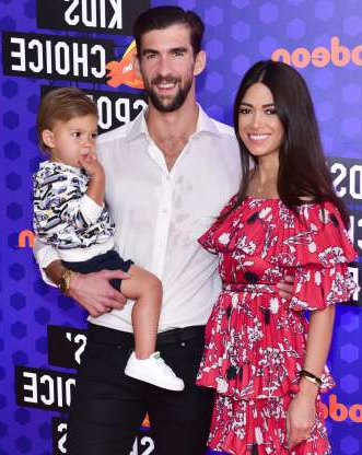 Slide 72 of 173: Retired competitive swimmer Michael Phelps and wife Nicole, a former model, are now parents of three.