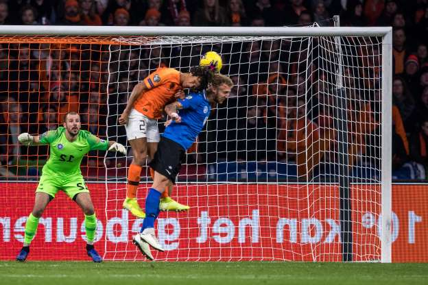 Slide 9 of 50: AMSTERDAM, NETHERLANDS - NOVEMBER 19: Nathan Ake (C) of Netherlands scores his team's second goal against Mihkel Ainsalu (L) and Goalkeeper Sergei Lepmets (R)  during the UEFA Euro 2020 Qualifier between The Netherlands and Estonia on November 19, 2019 in Amsterdam, Netherlands. (Photo by Lukas Schulze - UEFA/UEFA via Getty Images)