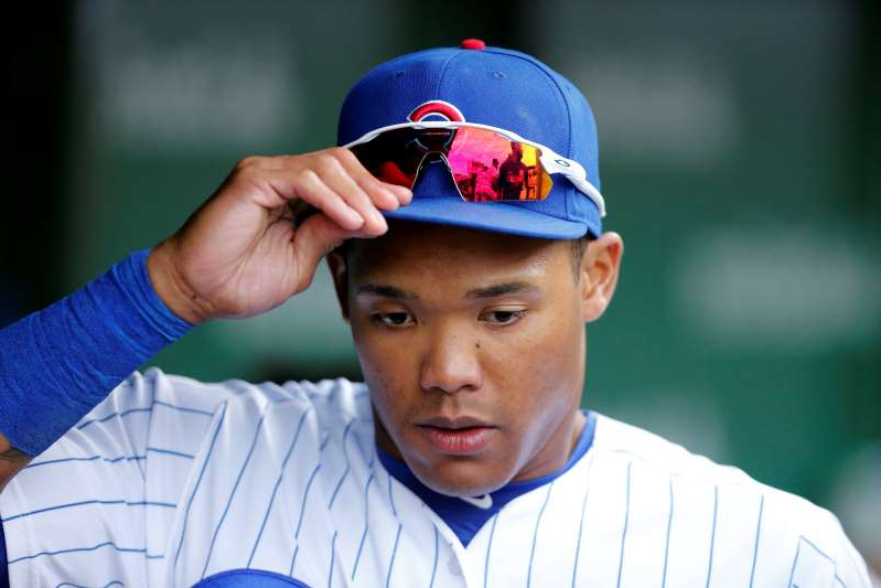 a baseball player holding a bat while wearing a hat: Addison Russell's time with the Cubs has come to an end. (Photo by Nuccio DiNuzzo/Getty Images)