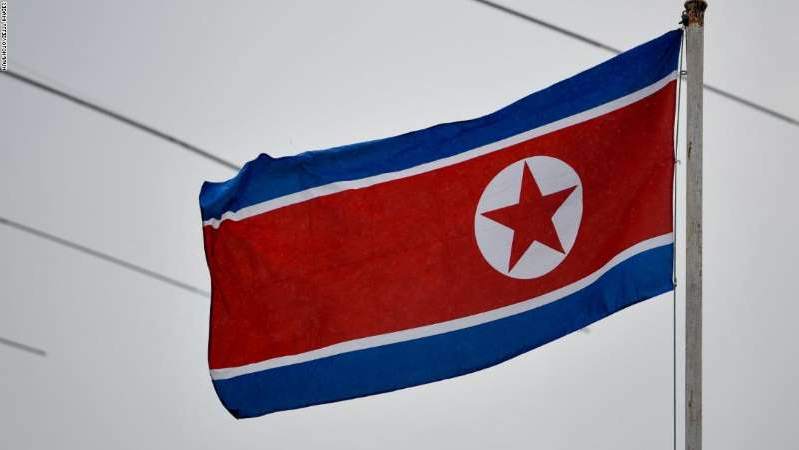 a flag hanging on a wall: The North Korean flag flies above the North Korean embassy in Kuala Lumpur, Malaysia.