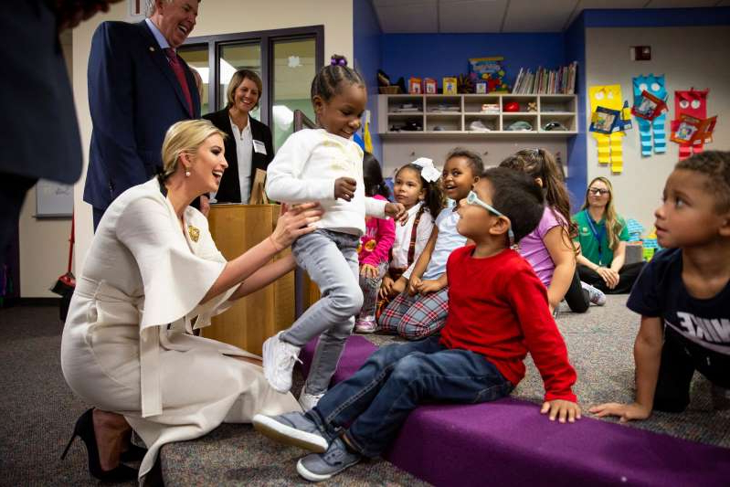 "a group of people around each other: Ivanka Trump visits a day care attached to Metropolitan Community College in Kansas City on Oct. 10. She is advising her father, President Donald Trump, on child care and paid family leave. As much as she believes her ""efforts are bearing fruit,"" Trump said she will have viewed her work ""as a failure if we don't pass legislation."""