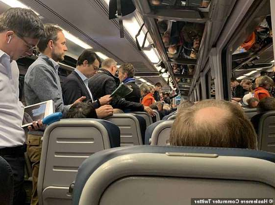 a group of people in a subway car: One commuter from Haslemere in Surrey posted this picture today of an overcrowded train