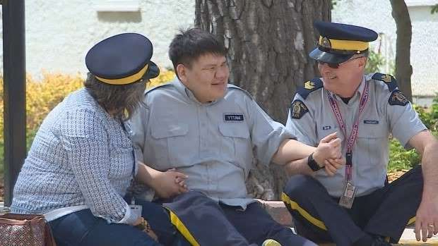a group of people sitting and looking at the camera: Gosselin still takes time every Tuesday to sit with Brandon and watch the Sergeant Major's Parade.