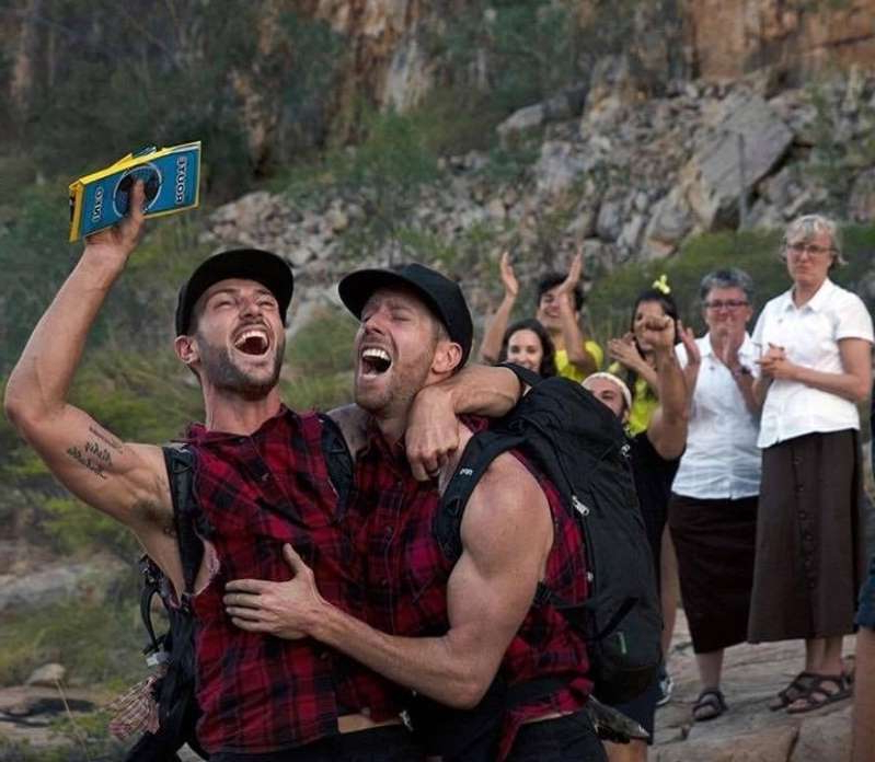 a group of people standing on top of a mountain: Network Ten