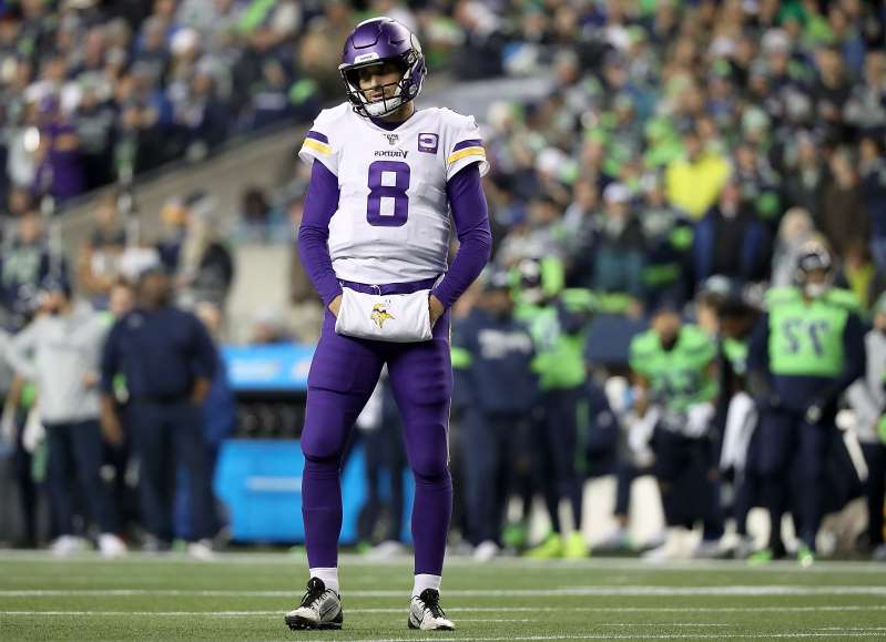 a group of people watching a football game: Quarterback Kirk Cousins of the Minnesota Vikings couldn't lead a late comeback win at Seattle. (Photo by Abbie Parr/Getty Images)