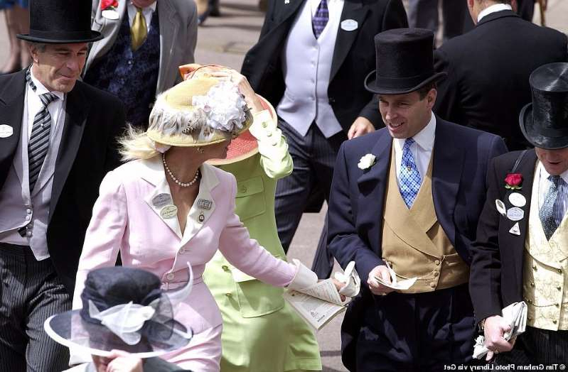 a group of people wearing military uniforms: Prince Andrew, left, with Ghislaine Maxwell, centre in a green jacket and pink hat, her face obscured by a lady in front, and Jeffrey Epstein, right, at Royal Ascot on June 22, 2000