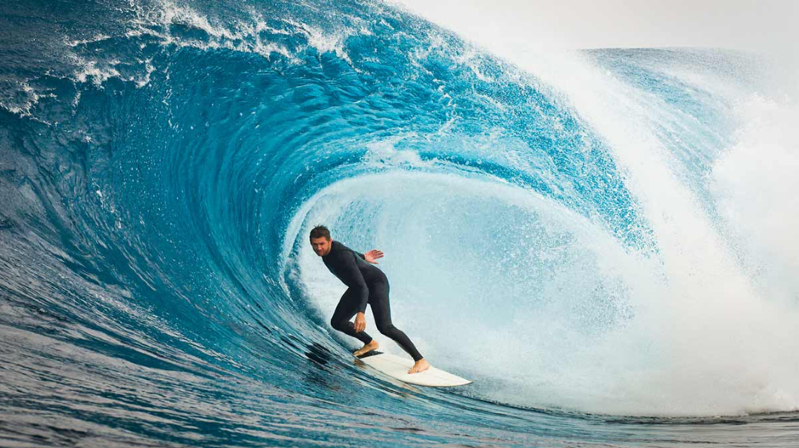 a man riding a wave on a surfboard in the ocean: Energy: Red Emperor is looking to ride the wave of the Perth Basin; shares surge