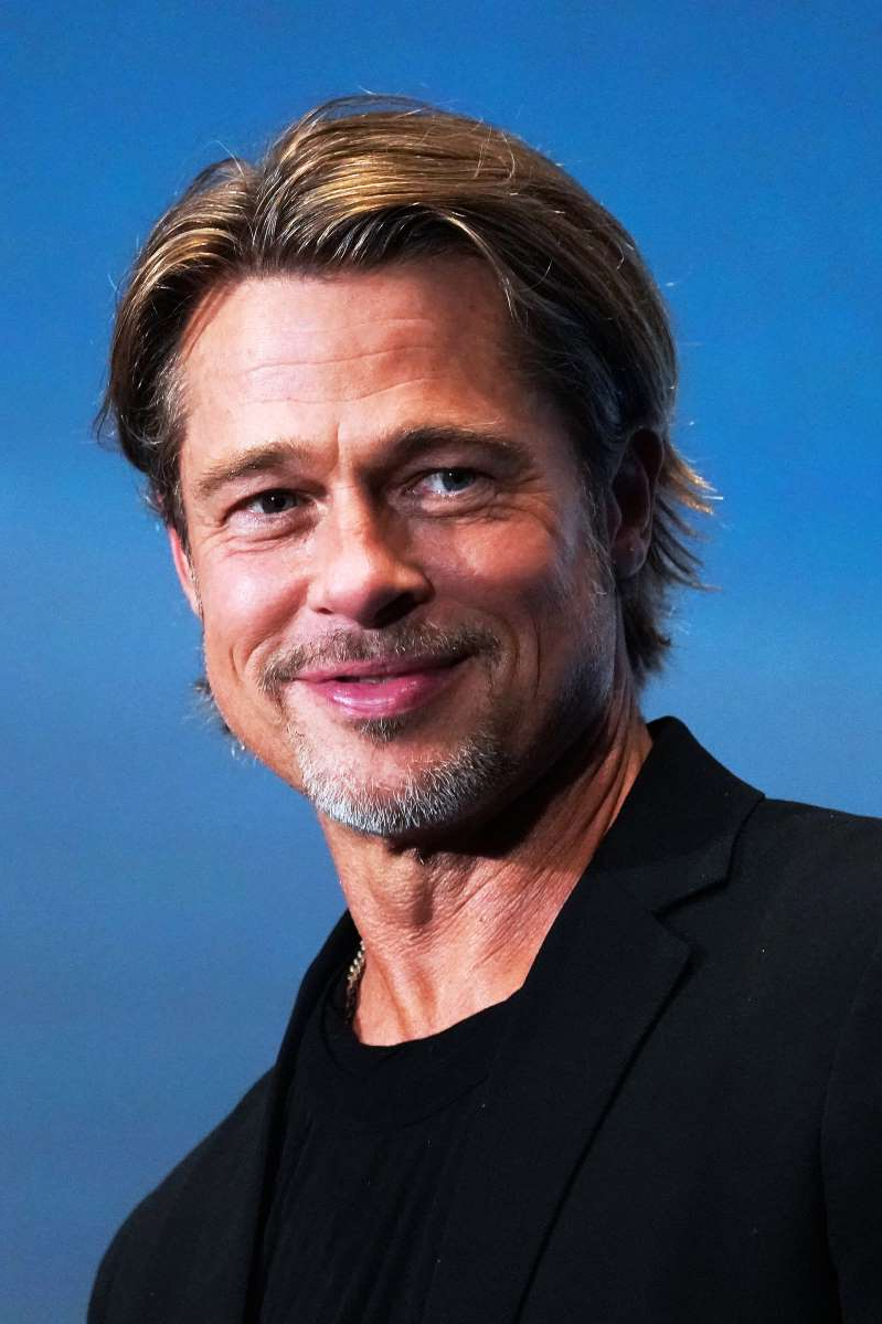 a man smiling for the camera: Brad Pitt at the Japan premiere of