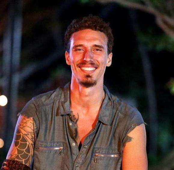 a man smiling for the camera: Luke became a fan favourite on Survivor and came in fourth place.