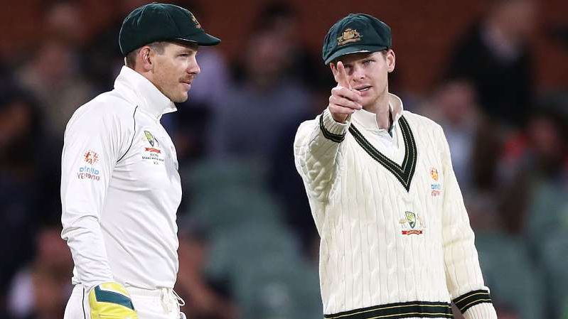 a man wearing a hat: Steve Smith and Tim Paine.