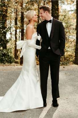a man wearing a suit and tie: Christian Huff and Sadie Robertson | Andrew James Abajian