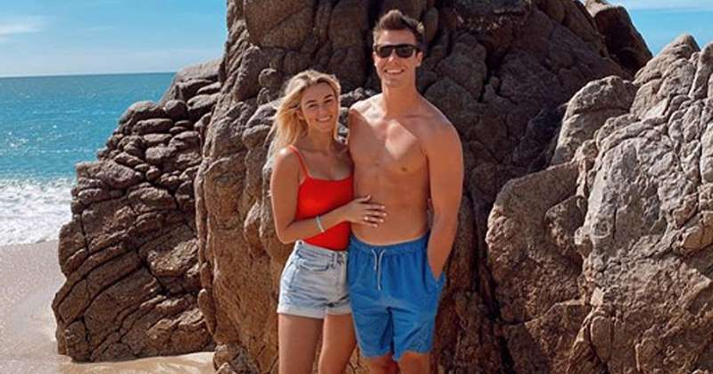 a person standing in a rocky area next to a body of water: Sadie Robertson Shares Photos from Honeymoon: 'It's Only Week 1 But Marriage Is Awesome'
