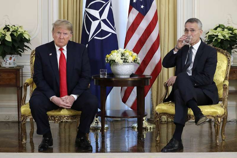 a statue of Donald Trump wearing a suit and tie: 191203_donald_trump_stoltenberg_nato_ap_773.jpg