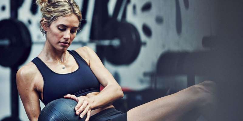 a woman sitting in a chair: Gross things that happen if you don't change your gym clothes.