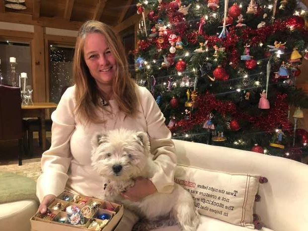 a woman standing in front of a white dog sitting on a table: Anneliese Wiesener says her father accidentally donated several boxes of vintage Christmas ornaments to Value Village in Brampton on the weekend and she is hoping that anyone who bought the treasured ornaments will return them.