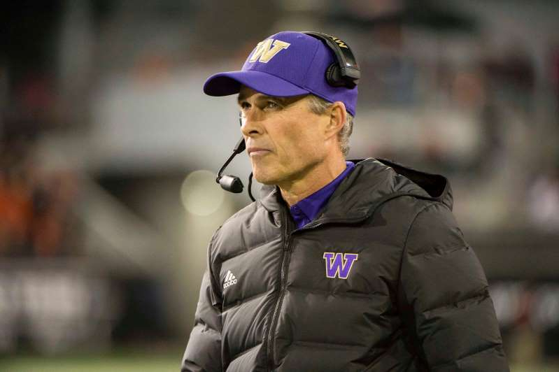 Chris Petersen wearing a hat: Chris Petersen says he will be taking time to recharge.