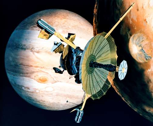 Folie 29 von 35: circa 1989:  NASA's Galileo probe passing over one of Jupiter's 16 moons. The planet's Great Red Spot, thought to be a surface storm, can be seen in the background.