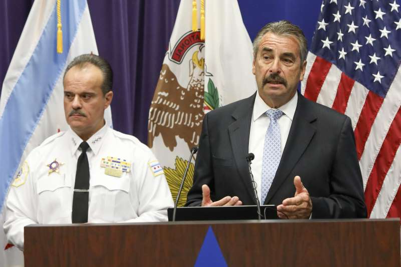 Former Los Angeles Police Chief Charlie Beck, left, who was named interim police superintendent in Chicago by Mayor Lori Lightfoot, addresses a news conference where he fielded questions on the firing by Lightfoot of retiring superintendent Eddie Johnson and Facebook gun sales Tuesday, Dec. 3, 2019. Standing with Beck is First Deputy Superintendent Anthony Riccio, as the pair announced that investigators have arrested more than 50 people accused of using private Facebook groups and messages to sell guns or drugs. Police also blamed the social media company for complicating such cases by taking down investigators' fake profiles during a Tuesday press conference announcing results of the two-year investigation. (AP Photo/Teresa Crawford)