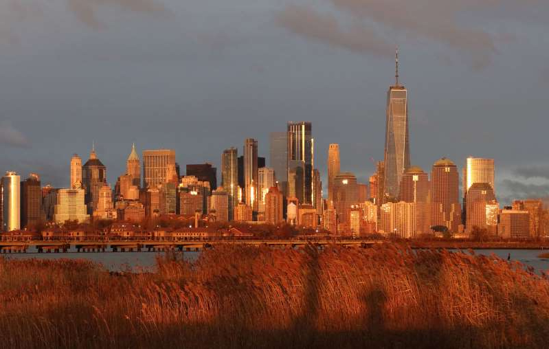 JERSEY CITY, NJ - NOVEMBER 24: The sun sets on the skyline of lower Manhattan and One World Trade Center in New York City on November 24, 2019 as seen from Jersey City, New Jersey. (Photo by Gary Hershorn/Corbis via Getty Images)