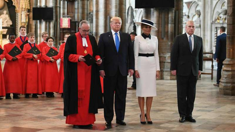 Prince Andrew, Duke of York, Donald Trump posing for the camera: President Trump, Melania Trump and Prince Andrew, left, during a tour of Westminster Abbey in London in June.
