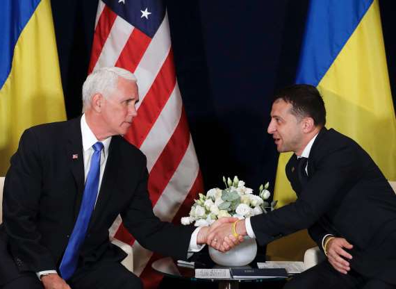 Slide 15 of 74: Zelensky, left, shakes hands with Vice President Mike Pence in Warsaw, Poland on Sept. 1, 2019. A Washinton Post article published on Oct. 2, 2019, reported Trump used Pence in his attempt to pressure the new Ukrainian president to dig up dirt on Joe Biden, but is not conclusive on how much Pence knew about Trump's efforts.