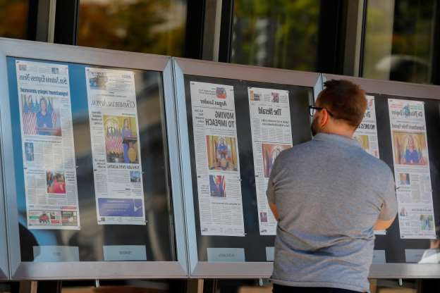 Slide 2 of 74: A man stops to look at newspaper front pages from around the U.S. on display at the Newseum in Washington, D.C., on Sept. 25, 2019. House Speaker Nancy Pelosi, D-Calif., announced on Sept. 24, 2019 she will launch a formal impeachment inquiry against President Donald Trump. A whistleblower's complaint alleged President Trump pressured the president of Ukraine to investigate his Democratic rival Joe Biden.