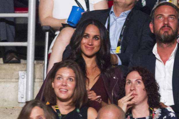 Slide 23 of 36: Meghan Markle, said to be Prince Harry's girlfriend, watches the opening ceremonies of the Invictus Games in Toronto, Ontario, September 23, 2017.