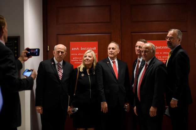 Slide 25 of 74: From left, Rep. Andy Harris, R-Md., Rep. Steve King, R-Iowa., Rep. Paul Gosar, R-Ariz., Rep. Andy Biggs, R-Ariz., Rep. Debbie Lesko, R-Ariz., and Rep. Louie Gohmert, R-Texas, pose for a group photo on Capitol Hill in Washington, Oct. 16, 2019, outside the room where people are interviewed for the impeachment inquiry.