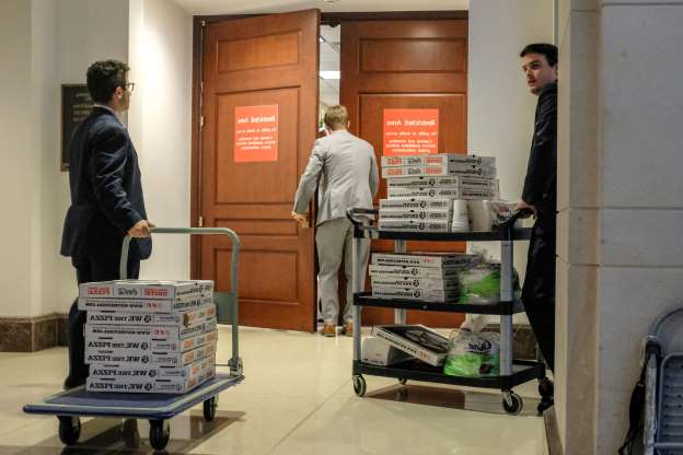 Slide 32 of 74: Staffers deliver pizza to a closed session before the House Intelligence, Foreign Affairs and Oversight committees on Capitol Hill on Oct. 23, 2019 in Washington, DC.