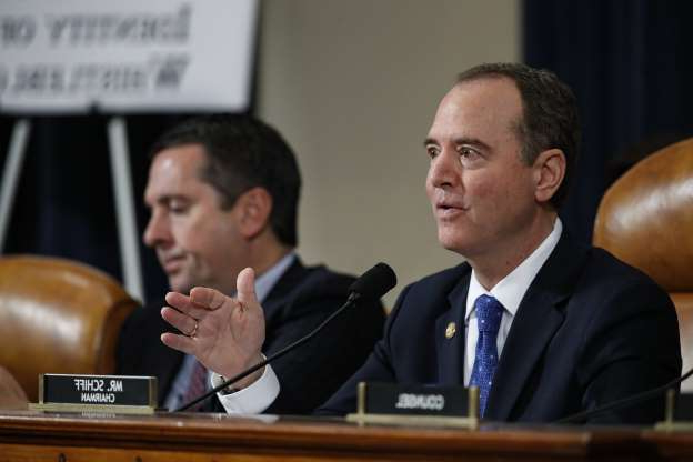 Slide 34 of 67: House Intelligence Committee Chairman Adam Schiff, D-Calif., questions U.S. Ambassador to the European Union Gordon Sondland testifies before the House Intelligence Committee on Capitol Hill in Washington, Wednesday, Nov. 20, 2019, during a public impeachment hearing of President Donald Trump's efforts to tie U.S. aid for Ukraine to investigations of his political opponents, as ranking member Rep. Devin Nunes of Calif., looks on.