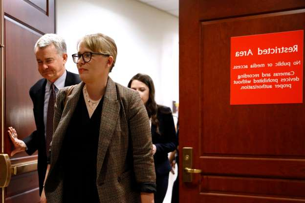 Slide 35 of 74: Catherine Croft, a State Department adviser on Ukraine, departs a secure area of the Capitol after a closed door meeting where she testified as part of the House impeachment inquiry into President Donald Trump, Oct. 30, 2019, on Capitol Hill in Washington.