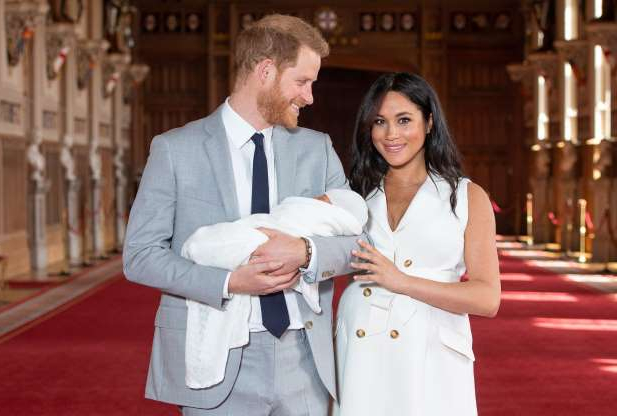 Slide 36 of 36: Britain's Prince Harry, Duke of Sussex (R), and his wife Meghan, Duchess of Sussex, pose for a photo with their newborn baby son in St George's Hall at Windsor Castle in Windsor, west of London on May 8, 2019. (Photo by Dominic Lipinski / POOL / AFP)        (Photo credit should read DOMINIC LIPINSKI/AFP/Getty Images)