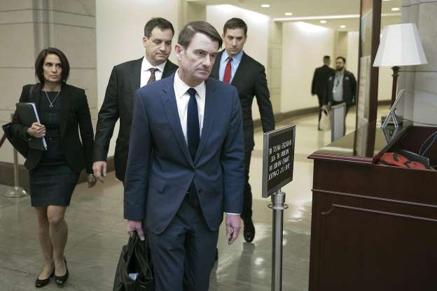 Slide 42 of 74: Under Secretary of State for Political Affairs David Hale (C) departs the U.S. Capitol after giving a closed-door deposition to the House committees conducting the impeachment inquiry of President Donald Trump Nov. 6, 2019 in Washington, DC.