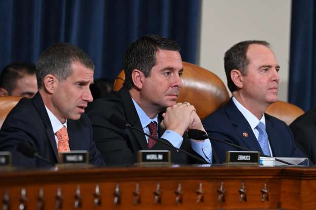 Slide 47 of 74: From left, House Intelligence Committee Chairman Adam Schiff, D-Calif. and ranking member Rep. Devin Nunes, R-Calif., listen as Steve Castor, Republican staff attorney for the House Oversight Committee addresses Former Ukraine ambassador Marie Yovanovitch on Nov. 15, 2019 during testimony before the Permanent Select Committee on Intelligence in a public hearing in the impeachment inquiry into allegations President Donald Trump pressured Ukraine to investigate his political rivals