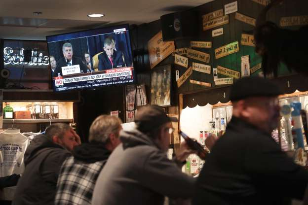 Slide 52 of 74: Live testimony of the House impeachment hearings against President Donald Trump is shown on a television at the Billy Goat Tavern on Nov. 13, 2019 in Chicago, Ill. In the first public impeachment hearings in more than two decades, House Democrats are making a case that U.S. President Donald Trump committed extortion, bribery or coercion by trying to enlist Ukraine to investigate political rivals in exchange for military aid and a White House meeting that Ukraine President Volodymyr Zelensky sought with Trump.