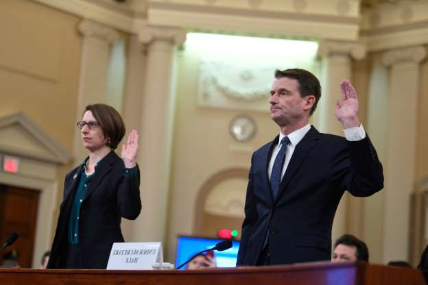 Slide 68 of 74: Defense Department official Laura Cooper and David Hale, Under Secretary of State for Political Affairs, are sworn before they testify before the Permanent Select Committee on Intelligence.