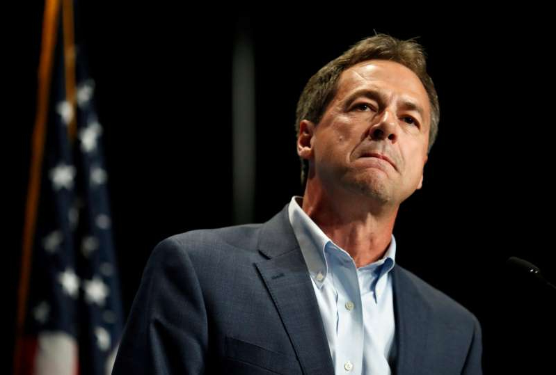Steve Bullock wearing a suit and tie: Democratic presidential candidate Steve Bullock, shown at the June 9 Iowa Democratic Party's Hall of Fame Celebration, announced Monday he is ending his campaign.