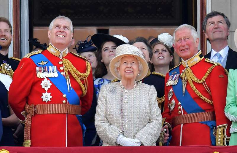 Timothy Laurence, Prince Charles, Elizabeth II, Prince Andrew, Duke of York posing for the camera: Britain's Prince Charles (left), Queen Elizabeth II and Prince Andrew (right) stand with other members of the royal family on the balcony of Buckingham Palace in London to watch a fly-past of aircraft by the Royal Air Force on June 8. (Daniel Leal-Olivas/AFP via Getty Images)