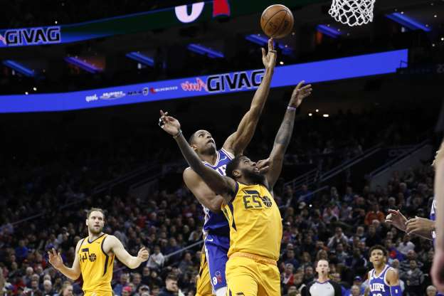 Utah Jazz's Royce O'Neale, center  left, and Philadelphia 76ers' Al Horford leap for a rebound during the first half of an NBA basketball game, Monday, Dec. 2, 2019, in Philadelphia. (AP Photo/Matt Slocum)