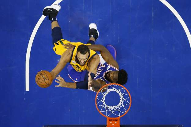 Utah Jazz's Rudy Gobert, right, goes up to shoot against Philadelphia 76ers' Joel Embiid during the first half of an NBA basketball game, Monday, Dec. 2, 2019, in Philadelphia. (AP Photo/Matt Slocum)