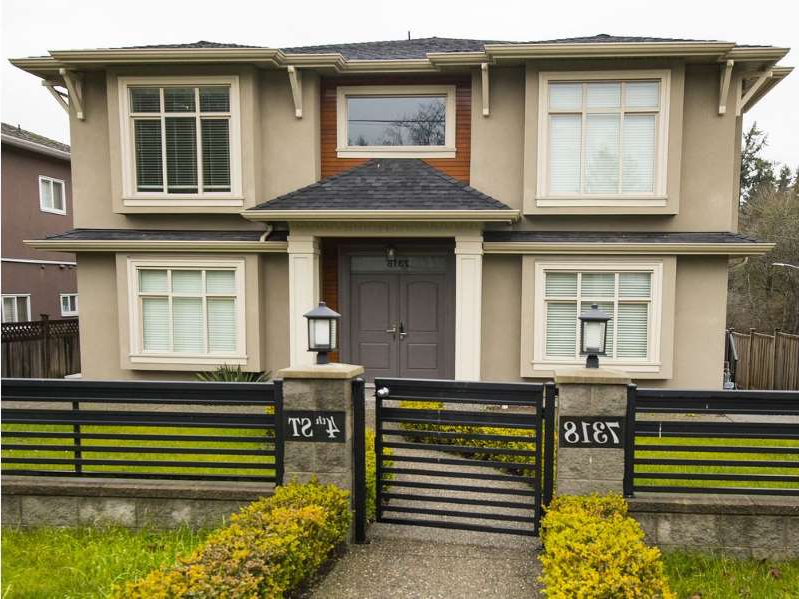 a bench in front of a building: The B.C. Civil Forfeiture Office is suing to seize this Burnaby house at 7318 Fourth St. as proceeds of crime. It's linked to an alleged Canada Revenue Agency scam.