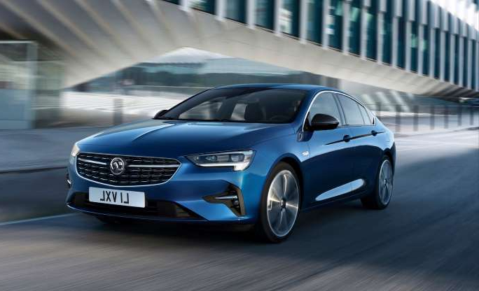 a car parked in front of a building: Vauxhall Insignia gains exterior and tech upgrades