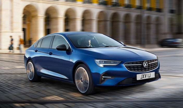 a car parked on the side of a road: Vauxhall Insignia gains exterior and tech upgrades