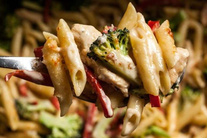 a close up of a plate of food with broccoli: creamy chicken broccoli alfedo bake recipe